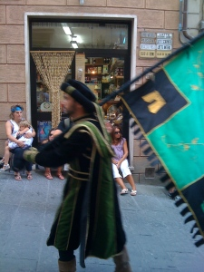 My contrada, Gracciano...Note Antonella across the street wearing her Poggiolo colors and holding Natalie on her lap