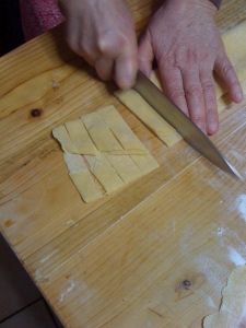 Cutting the pasta into strips...